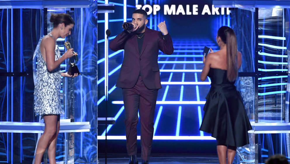 LAS VEGAS, NEVADA - MAY 01: Drake (C) accepts the Top Male Artist award from Cobie Smulders (L) and Eva Longoria (R) onstage