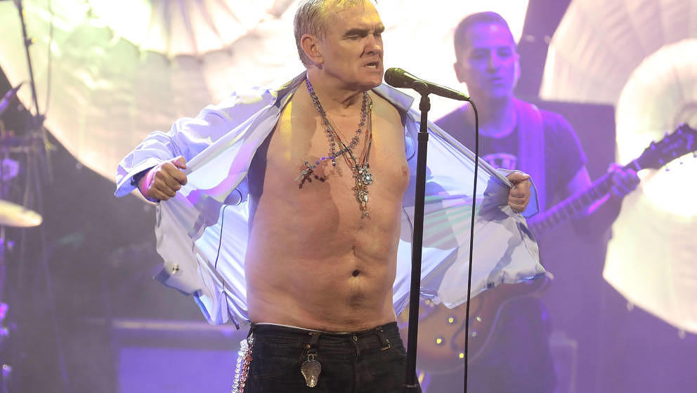 NEW YORK, NY - MAY 02: Morrissey rips off his shirt during the encore as he performs during his Broadway debut at Lunt-Fontan