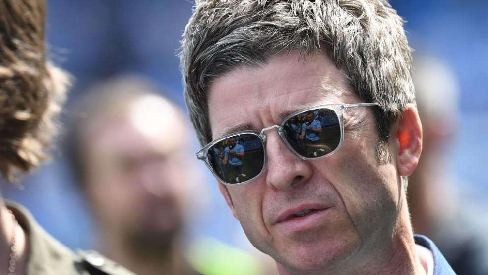 Manchester City fan, singer Noel Gallagher is pictured on the pitch before the English Premier League football match between