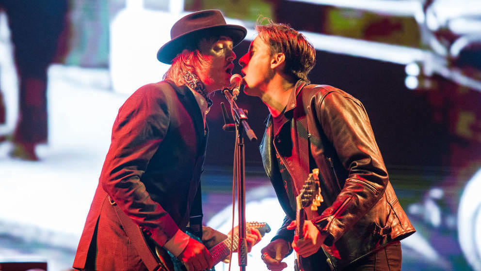 PORTSMOUTH, ENGLAND - AUGUST 24:  Pete Doherty and Carl Barat of The Libertines perform on stage on Day 1 of Victorious Festi
