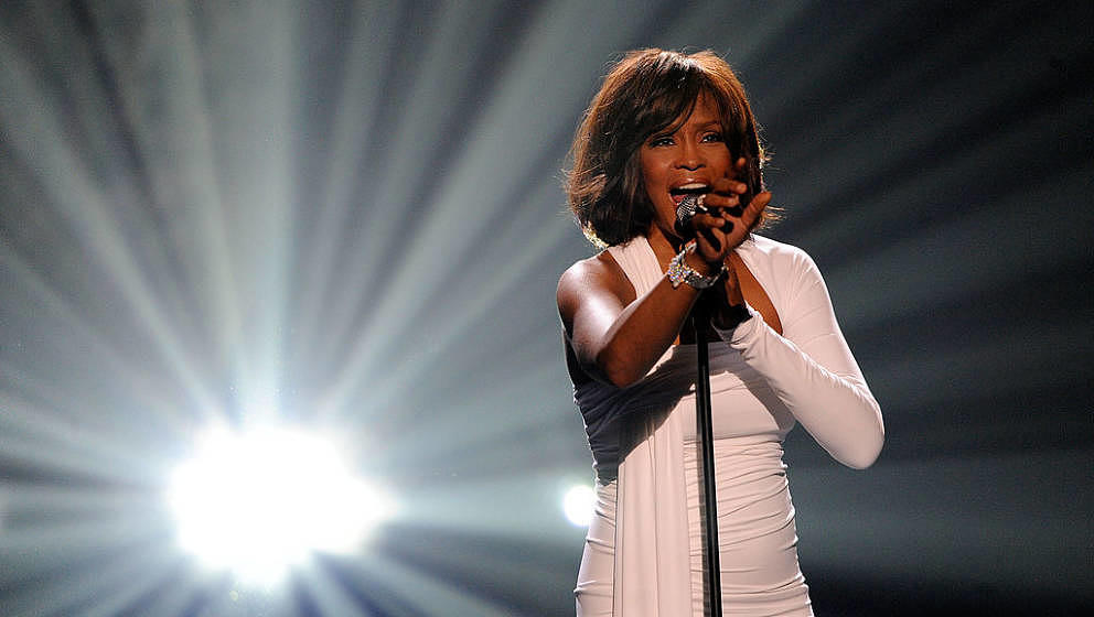 LOS ANGELES, CA - NOVEMBER 22:  Singer Whitney Houston accepts the Winner of International - Favorite Artist Award onstage at