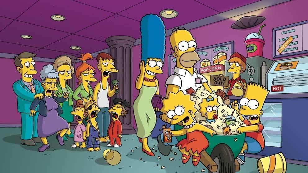 Im neuen Kinofilm 'Die Simpsons - Der Film' fährt die ganze Familie Simpson (Gruppe rechts) mit einer Schubkarre durch ein K