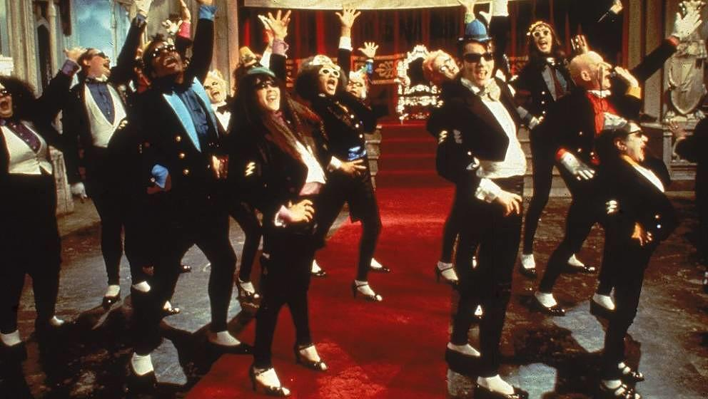 1975, Cast members in costume perform the dance 'The Time Warp' in a still from the musical film 'The Rocky Horror Picture Sh