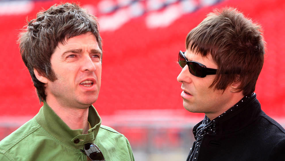 LONDON - OCTOBER 16: L-R Noel and Liam Gallagher attend the Oasis photocall in Wembley Stadium to promote their new album 'Di