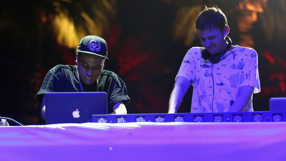 INDIO, CA - APRIL 12:  DJs Lunice and Hudson Mohawke of TNGHT perform onstage during day 1 of the 2013 Coachella Valley Music