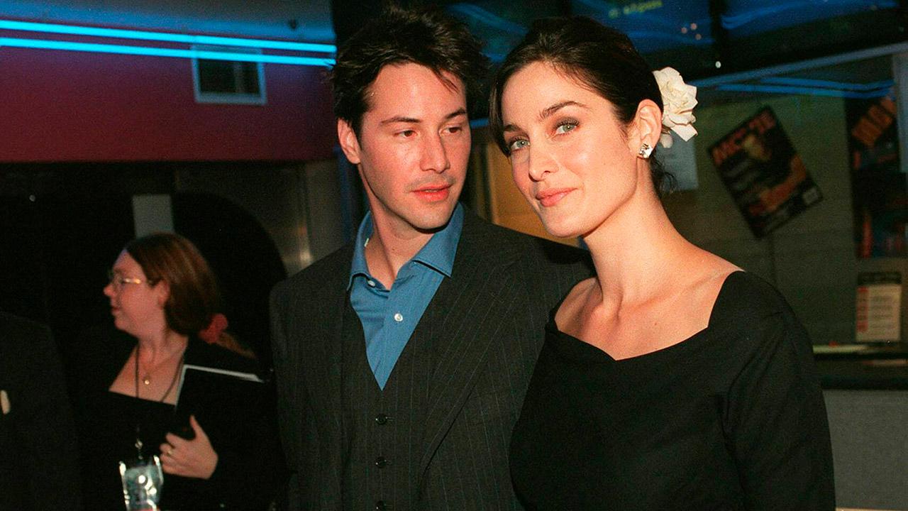 """Carrie-Anne Moss und Keanu Reeves bei der Australien-Premiere von """"The Matrix"""" im Jahr 1999"""