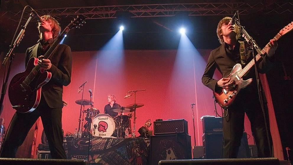 BERLIN - NOVEMBER 20:  (L-R) Gustaf Noren drummer Samuel Giers and Bjoern Dixgard of the Swedish rock band Mando Diao perform