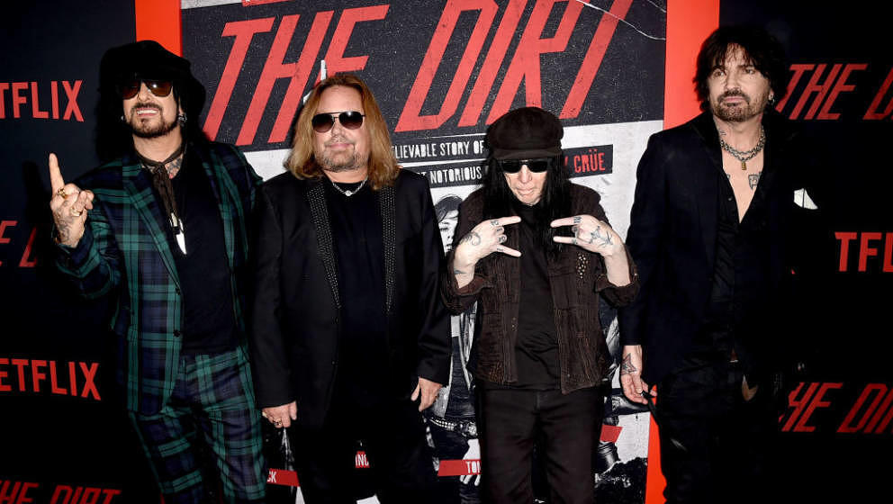 HOLLYWOOD, CALIFORNIA - MARCH 18: (L-R) Nikki Sixx, Vince Neil, Mick Mars and Tommy Lee of Motley Crue arrive at the premiere
