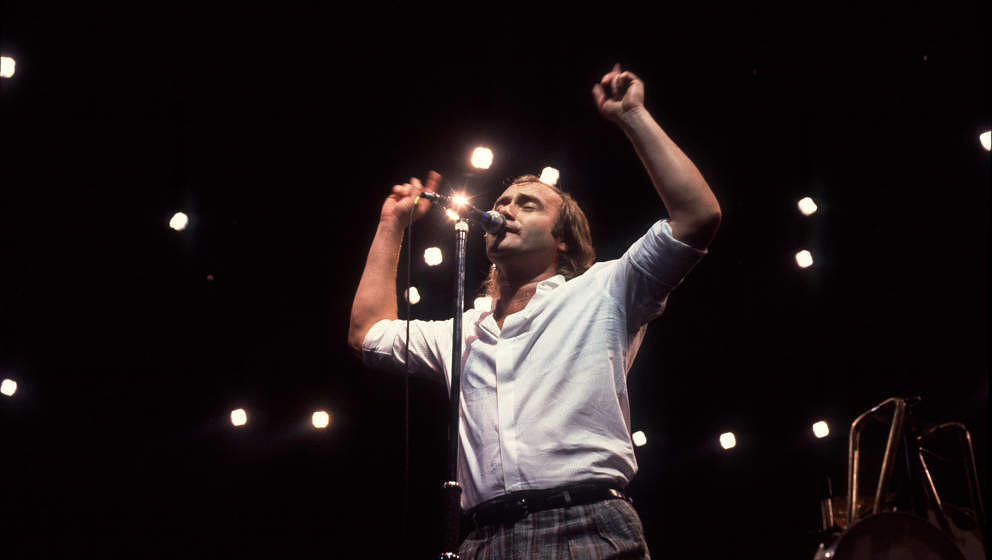 British Pop and Rock musician Phil Collins of the group Genesis performs onstage at the Rosemont Horizon, Rosemont, Illinois,