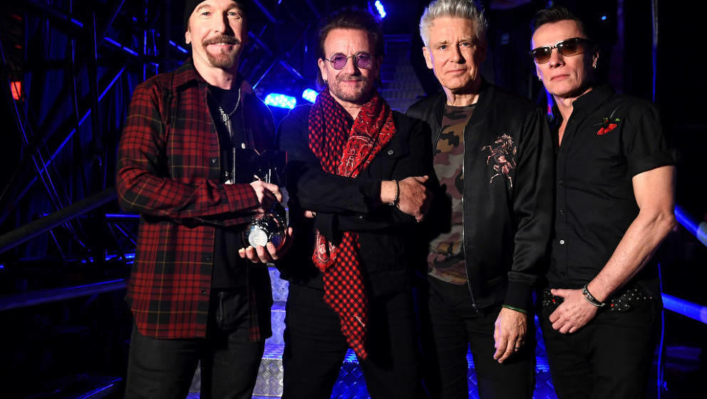 LONDON, ENGLAND - NOVEMBER 12:  (L-R) The Edge, Bono, Adam Clayton and Larry Mullen Jr of U2 pose with the Global Icon award
