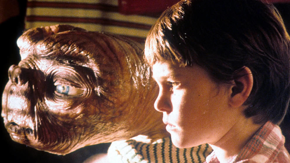 ET looking out window with Henry Thomas in a scene from the film 'E.T. The Extra-Terrestrial', 1982. (Photo by Universal/Gett