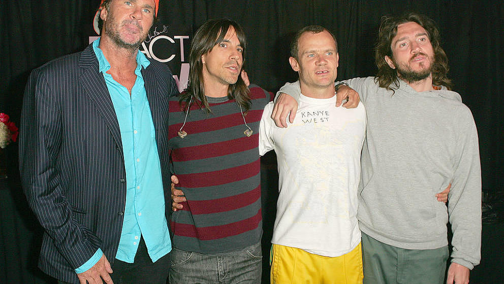 Chad Smith, Anthony Kiedis, Flea and John Frusciante of The Red Hot Chili Peppers after signing items for auction in MTV, VH1