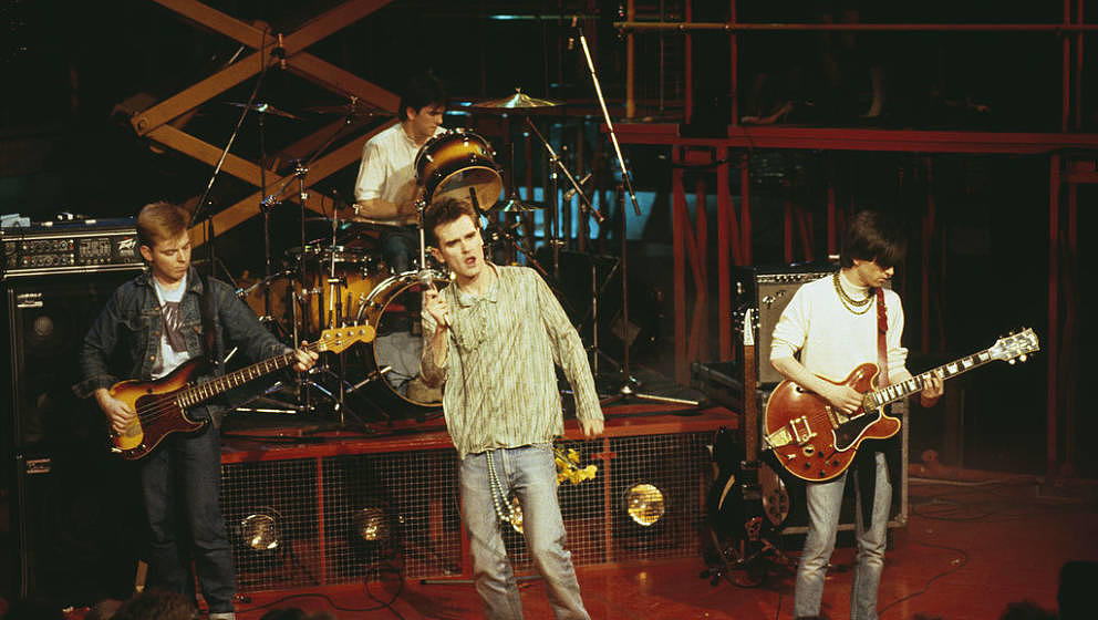 English rock band, The Smiths (L-R; Andy Rourke, Mike Joyce,  Morrissey, and Johnny Marr), perform live on stage, 1984. (Phot