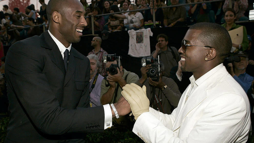 Kobe Bryant and Kanye West during 32nd Annual American Music Awards - Red Carpet at Shrine Auditorium in Los Angeles, Califor