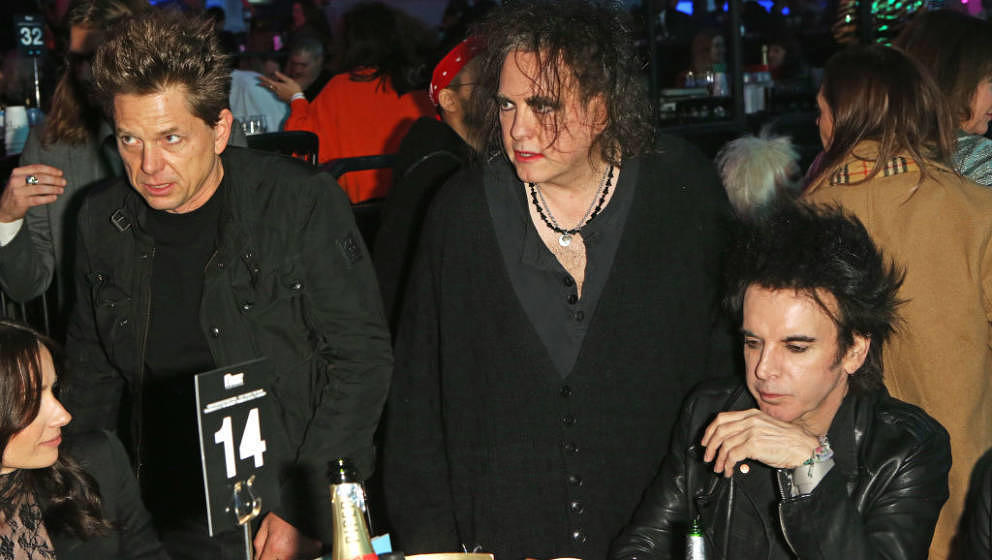 LONDON, ENGLAND - FEBRUARY 12: (L to R) Jason Cooper, Robert Smith and Simon Gallup of The Cure attend The NME Awards 2020 at