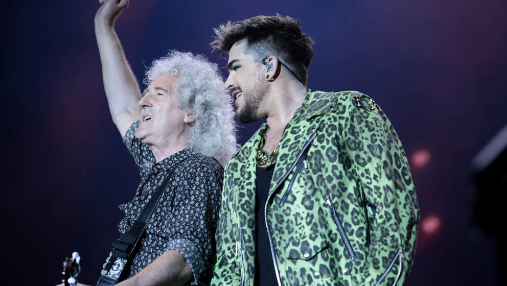 SYDNEY, AUSTRALIA - FEBRUARY 16: Adam Lambert (R) performs with Brian May of Queen during Fire Fight Australia at ANZ Stadium