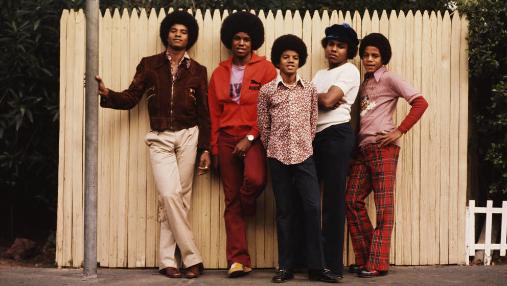 The Jackson brothers pose for a portrait in the backyard of their home, Los Angeles, 1972. From left to right, Jackie Jackson