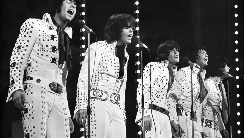 LONDON, ENGLAND – CIRCA 1973: The Osmonds performing on stage at the London Palladium circa 1973 in London, England. (Phot