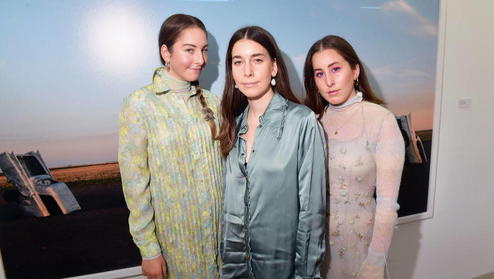 PARIS, FRANCE - SEPTEMBER 28: Danielle Haim, Este Haim and Alana Haim from the band HAIM attend exhibition hosted by Acne Stu