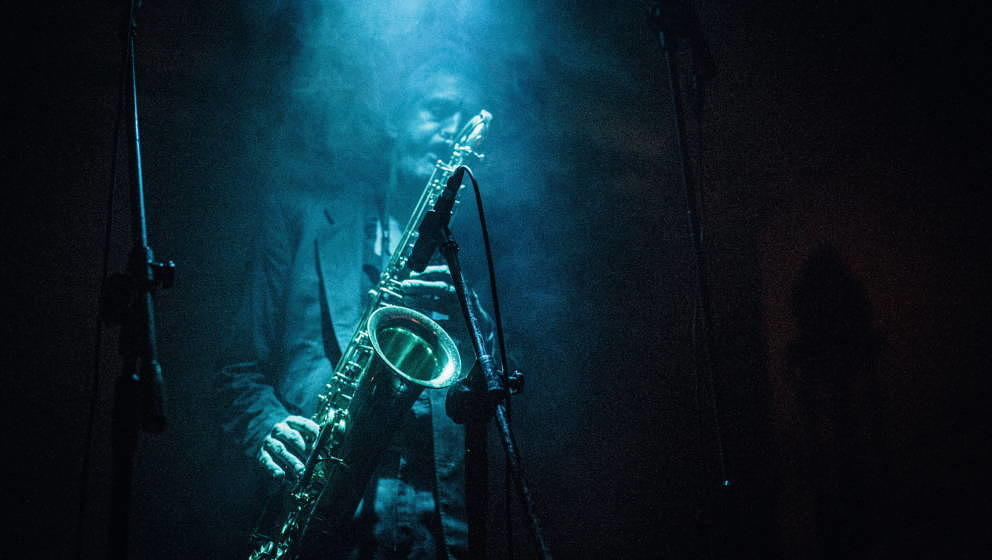 Musician and saxophonist Christoph Clöser from the German jazz band Bohren & der Club of Gore pictured in a light be