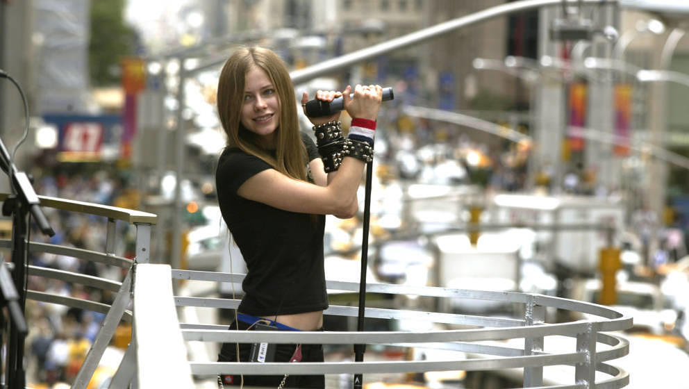 Avril Lavigne rehearsing for the 2002 MTV Video Music Awards on the marquee overlooking Avenue of the Americas at Radio City