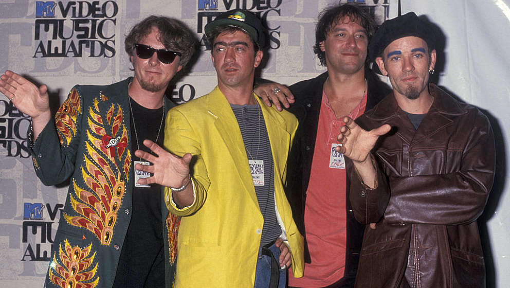 (L-R) Musicians Mike Mills, Bill Berry, Peter Buck and Michael Stipe of R.E.M attend 10th Annual MTV Video Music Awards on Se