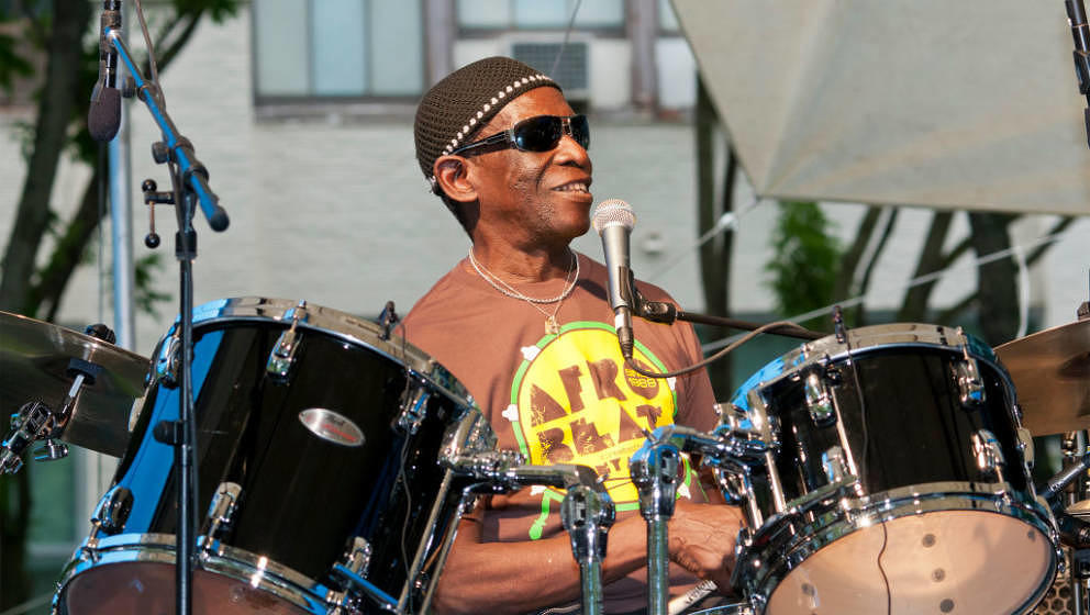 Nigerian Afro-Beat musician Tony Allen plays drums as he leads his band during a performance at the BAM Rhythm and Blues Fest