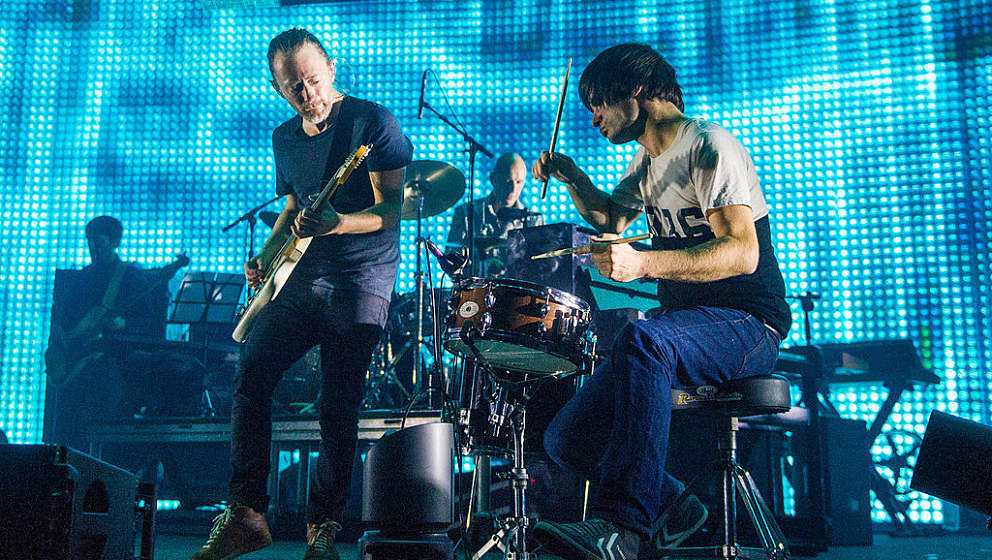 LONDON - OCTOBER 8: (L-R) Thom Yorke, Phil Selway and Jonny Greenwood of Radiohead perform at the 02 Arena on October 8, 2012
