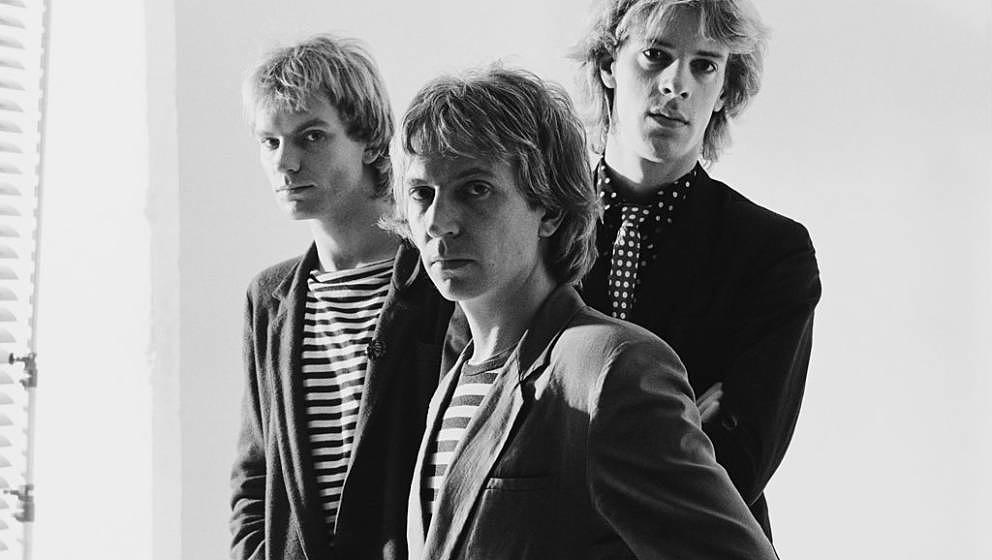 The Police (bassist and singer Sting, guitarist Andy Summers, and drummer Stewart Copeland), British rock band, pose for a gr