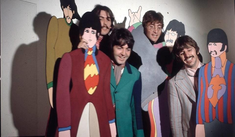 The Beatles posed with cardboard cutouts of their 'Yellow Submarine' characters at TVC animation Studios in London, 6th Novem