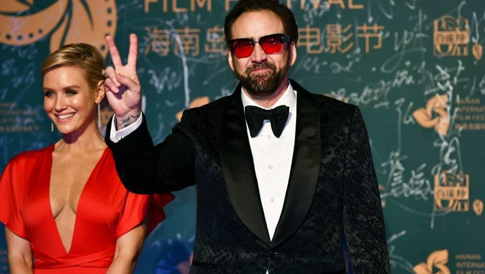 SANYA, CHINA - DECEMBER 11: American actor Nicolas Cage poses on the red carpet during the opening ceremony of the 1st Hainan
