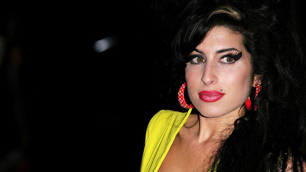 LONDON - FEBRUARY 14:  Singer Amy Winehouse arrives at the BRIT Awards 2007 in association with MasterCard at Earls Court on