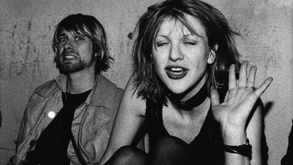 LOS ANGELES- DECEMBER 4: Kurt Cobain and Courtney Love pose for photograph, Kurt grimacing for the camera and Courtney waving
