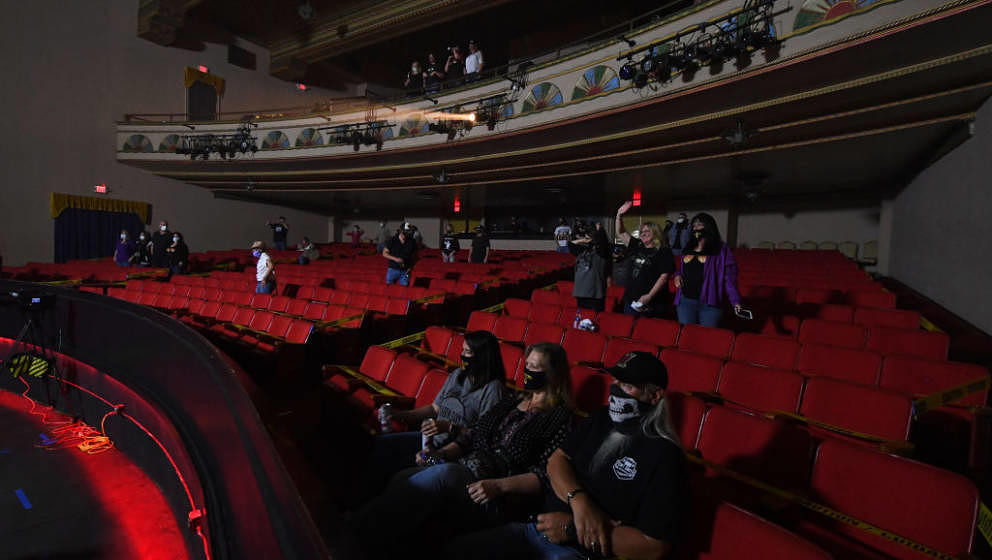 FORT SMITH, ARKANSAS - MAY 18: Audience members watch Travis McCready perform on stage during the first socially-distanced co