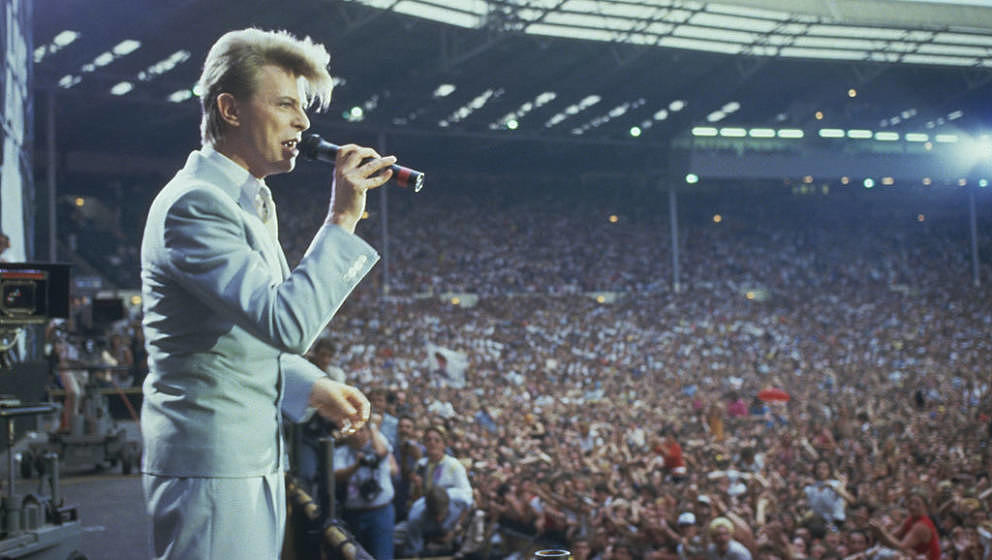 English singer David Bowie performing at the Live Aid concert at Wembley Stadium in London, 13th July 1985. The concert raise