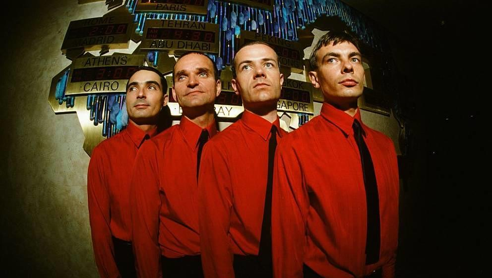 (MANDATORY CREDIT Koh Hasebe/Shinko Music/Getty Images) Kraftwerk in front of world time clock in Keio Plaza Hotel, Tokyo, Se
