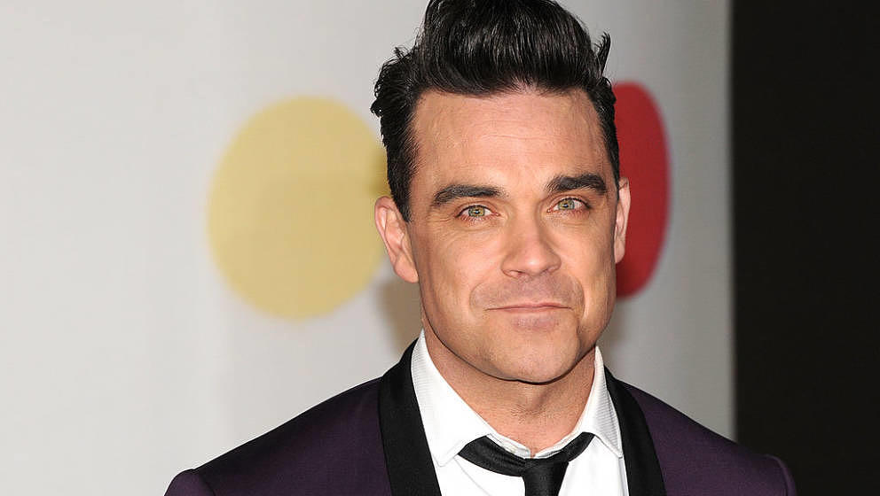 LONDON, ENGLAND - FEBRUARY 20:  Robbie Williams attends the Brit Awards 2013 at the 02 Arena on February 20, 2013 in London,