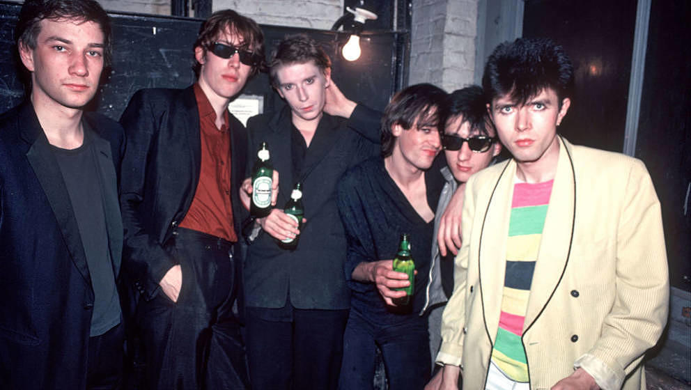 Portrait of British Rock group the Psychedelic Furs as they pose backstage at the Mudd Club, New York, New York, June 22, 198
