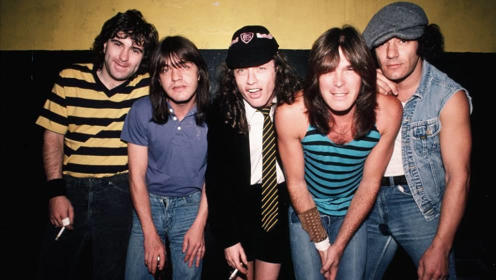 INGLEWOOD, CA - OCTOBER 18, 1985:  Drummer Simon Wright, rhythm guitarist Malcolm Young, lead guitarist Angus Young, bassist