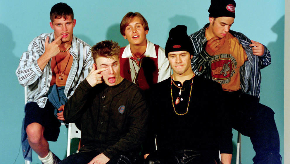 Mark Owen, Howard Donald, Gary Barlow, Robbie Williams and Jason Orange of Take That in Tokyo, March 1993 (Photo by Dave Hoga