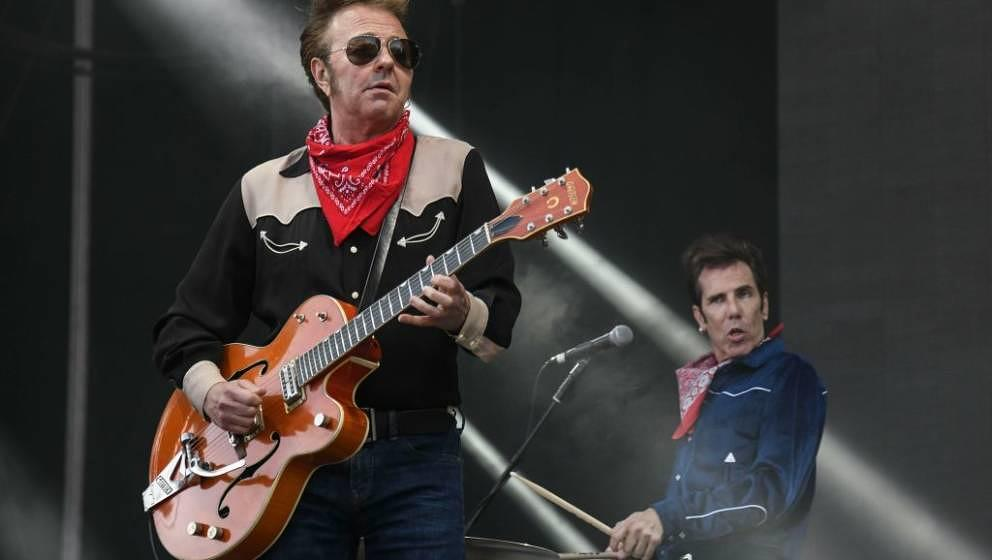 US singer and guitarist Brian Setzer (L) and US drummer Slim Jim Phantom, of the US band the Stray Cats, perform on stage dur