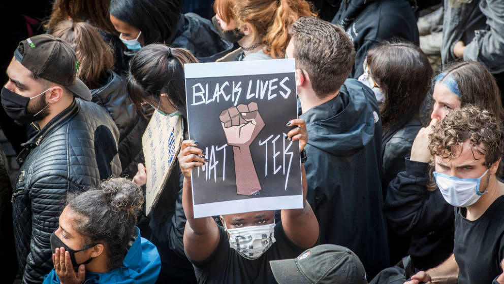 FRANKFURT, GERMANY - JUNE 06: Protesters gather together in tribute to George Floyd during a demonstration against racism and