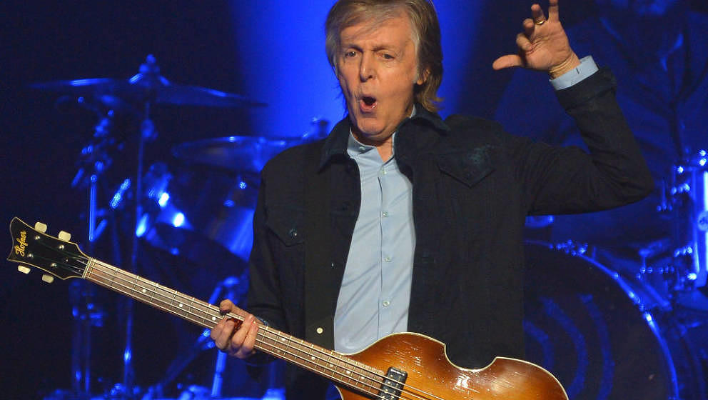 LONDON, ENGLAND - DECEMBER 16:  Sir Paul McCartney performs live on stage at the O2 Arena during his 'Freshen Up' tour, on De