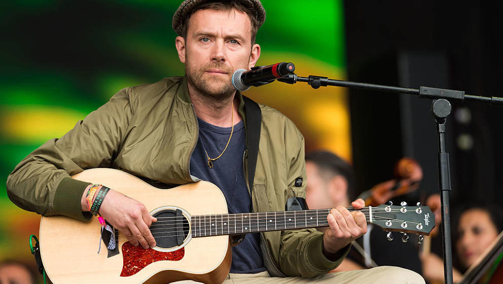 GLASTONBURY, ENGLAND - JUNE 24:  Damon Albarn and The Orchestra of Syrian Musicians perform on the Pyramid Stage at the Glast