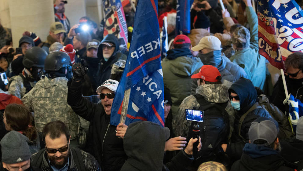 WASHINGTON, DC - JANUARY 06: A pro-Trump mob breaks into the U.S. Capitol on January 06, 2021 in Washington, DC. Congress hel