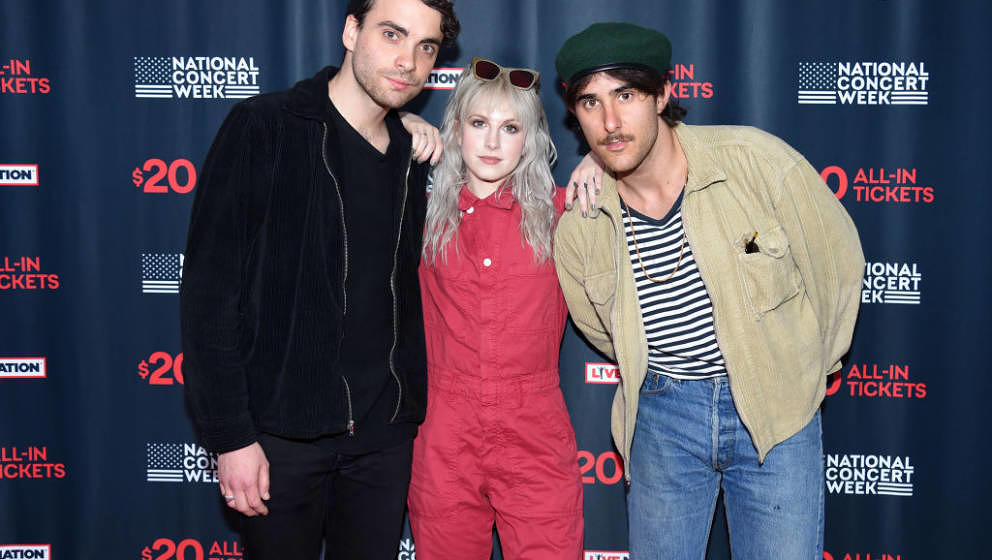 NEW YORK, NY - APRIL 30:  (L-R) Taylor York, Hayley Williams, and Zac Farro of Paramore attend Live Nation's celebration of t
