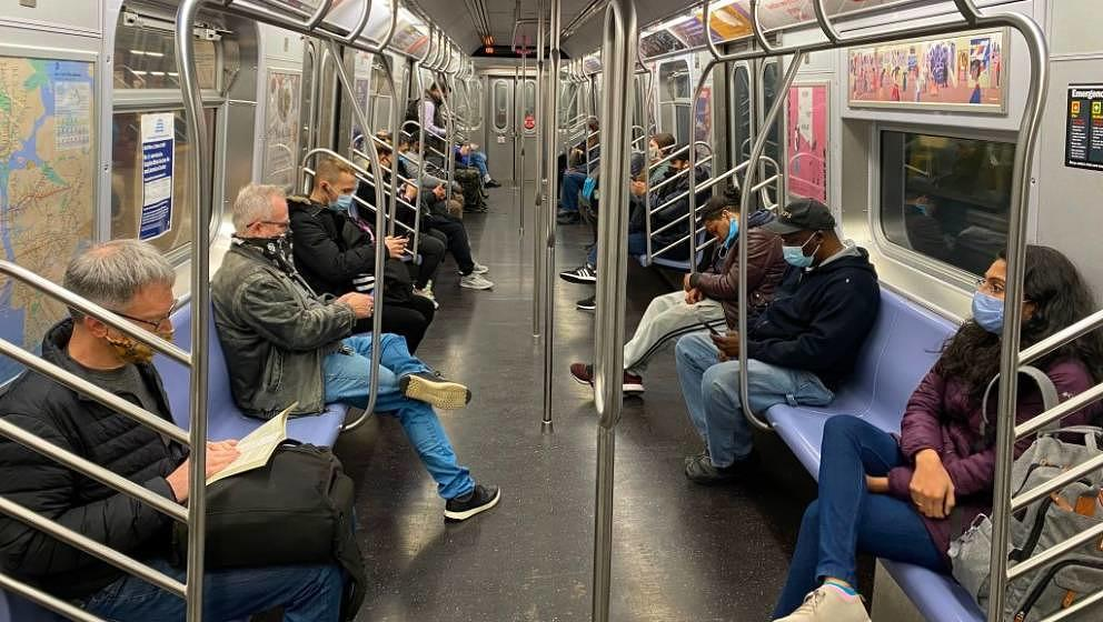 Commuters ride the New York City Subway on November 5, 2020, as the coronavirus pandemic continues worldwide. (Photo by Danie