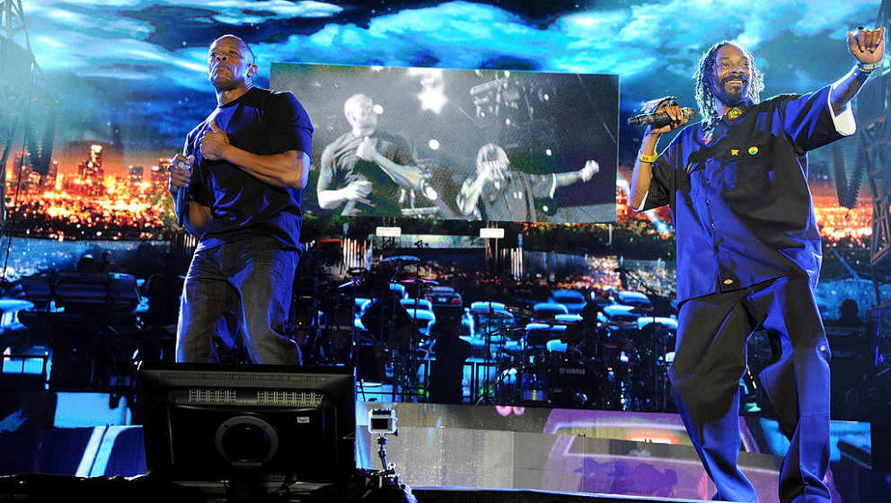 INDIO, CA - APRIL 22: Snoop Dogg and Dr Dre performs at day 3 of the 2012 Coachella Valley Music & Arts Festival at The E