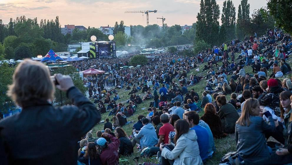 BERLIN, GERMANY - JUNE 21:  People enjoy in Mauerpark district during the annual 'Fete de la Musique' music fest on June 21,