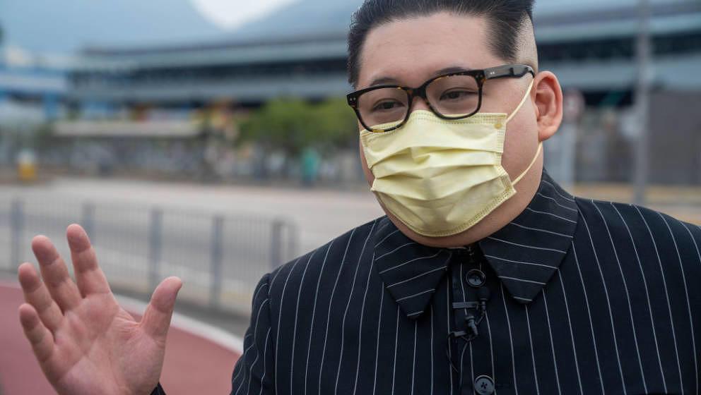 HONG KONG, CHINA - 2020/12/09: North Korean leader Kim Jong Un impersonator Howard X seen wearing a facemask as preventive me